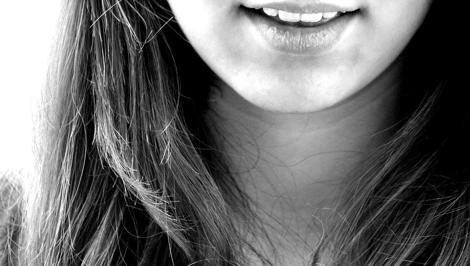 Young woman close-up smiling (cosmetic dentistry)