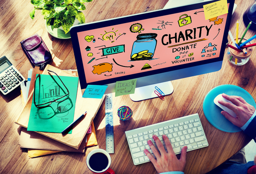 get the most from giving: computer screen with charity related graphics and man sitting at desk looking at it