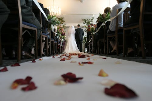bridal anxiety: couple walking up the aisle.