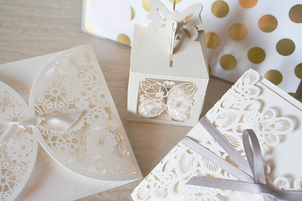white wedding invitations on a table