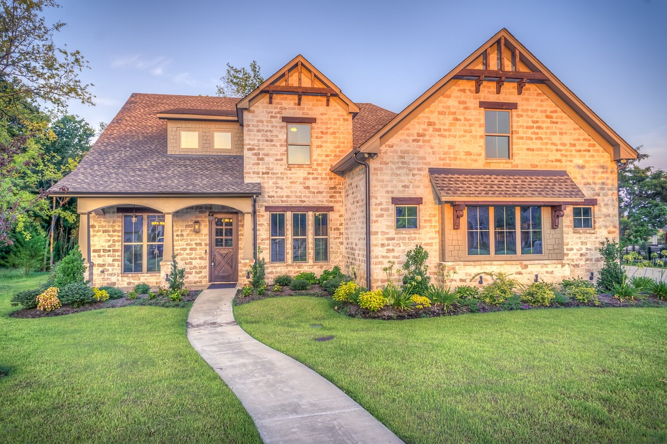 a big house with a green lawn: first time homeowners