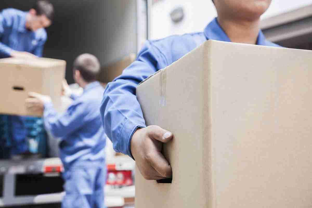man moving cardboard box: regret after moving home