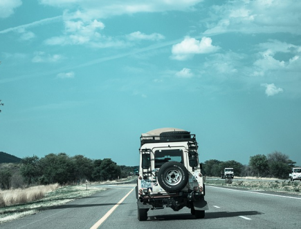 road trip budget: Jeep on road.