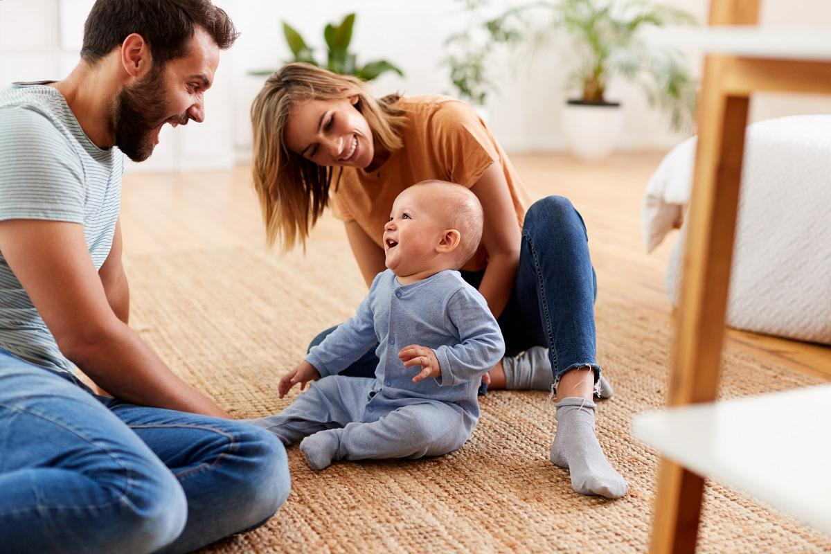 upsizing your home: family sitting with baby
