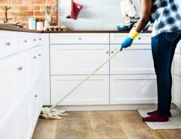 cleaning your home: person mopping kitchen floor.