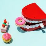 preventative dental care: red and white mouth plastic toy and food plastic toys