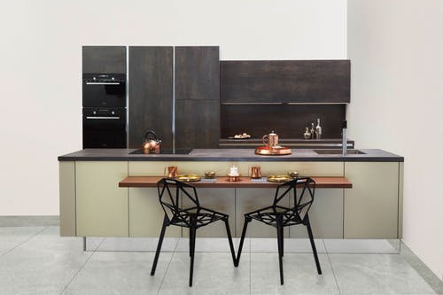 simple living: simple kitchen with breakfast bar and black chairs.
