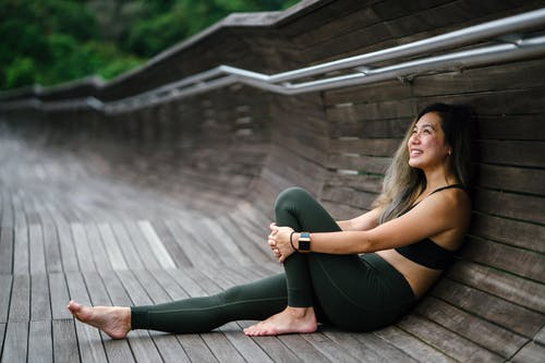 find success: woman resting against a wall.