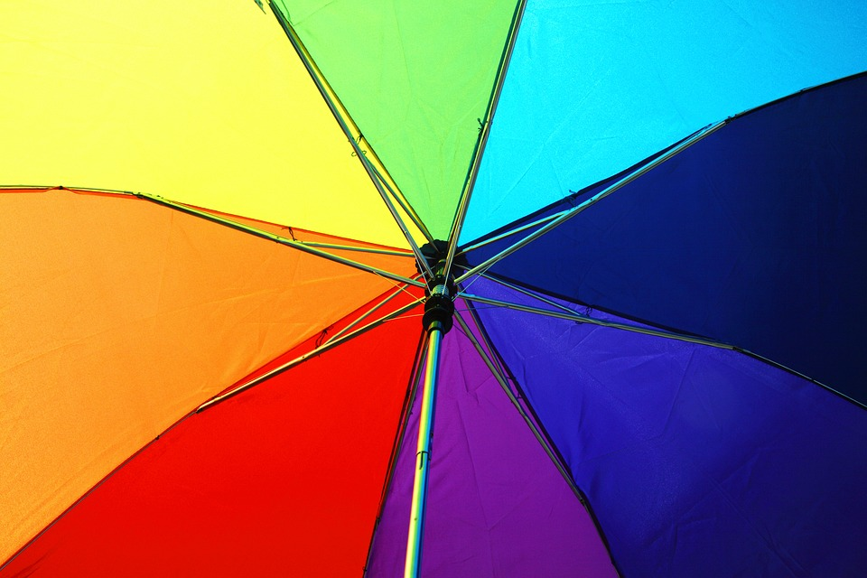 dating a transgender: muliti-coloured umbrella - view from underneath it.