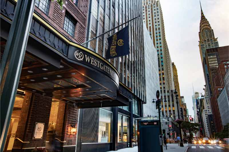 hotels in manhattan: hotel facade with empire state building in nyc in the background