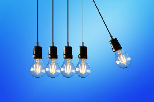 home energy audir: 5 hanging bulbs, the one on the far right swinging.