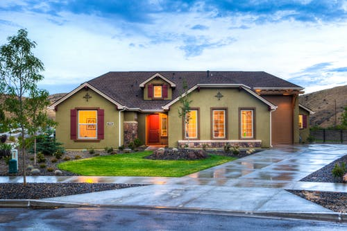 home in evening from street view: curb appeal