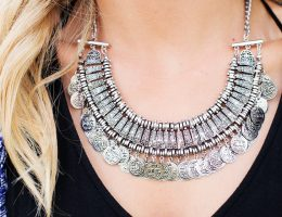 close up of a woman's neck and a big necklace