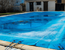 pool cover pumps: uncovered pool with dirty water