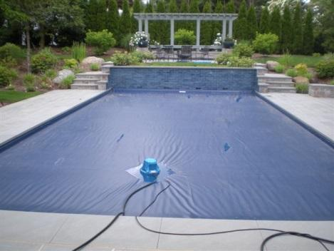 pool with cover on and pool cover pumps