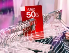best deals: clothes rack with red 50% off hanger.