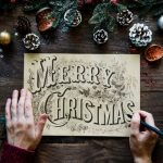 Christmas cards - person writing a message.