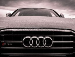 buying a car: front of black audi in the rain.