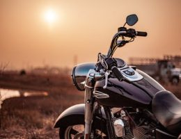 selling your motorbike: black motorbike in sunset.