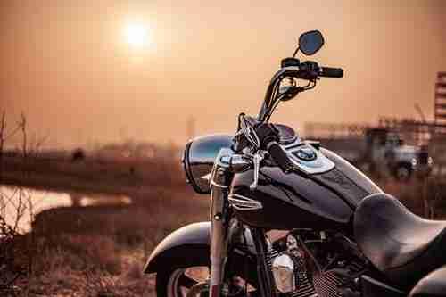 selling your motorbike: black motorbike in sunset.