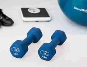 home gym essentials: blue pair of dumbbells
