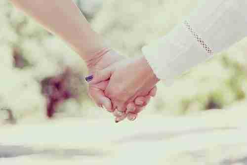 Romantic partner: couple holding hands.