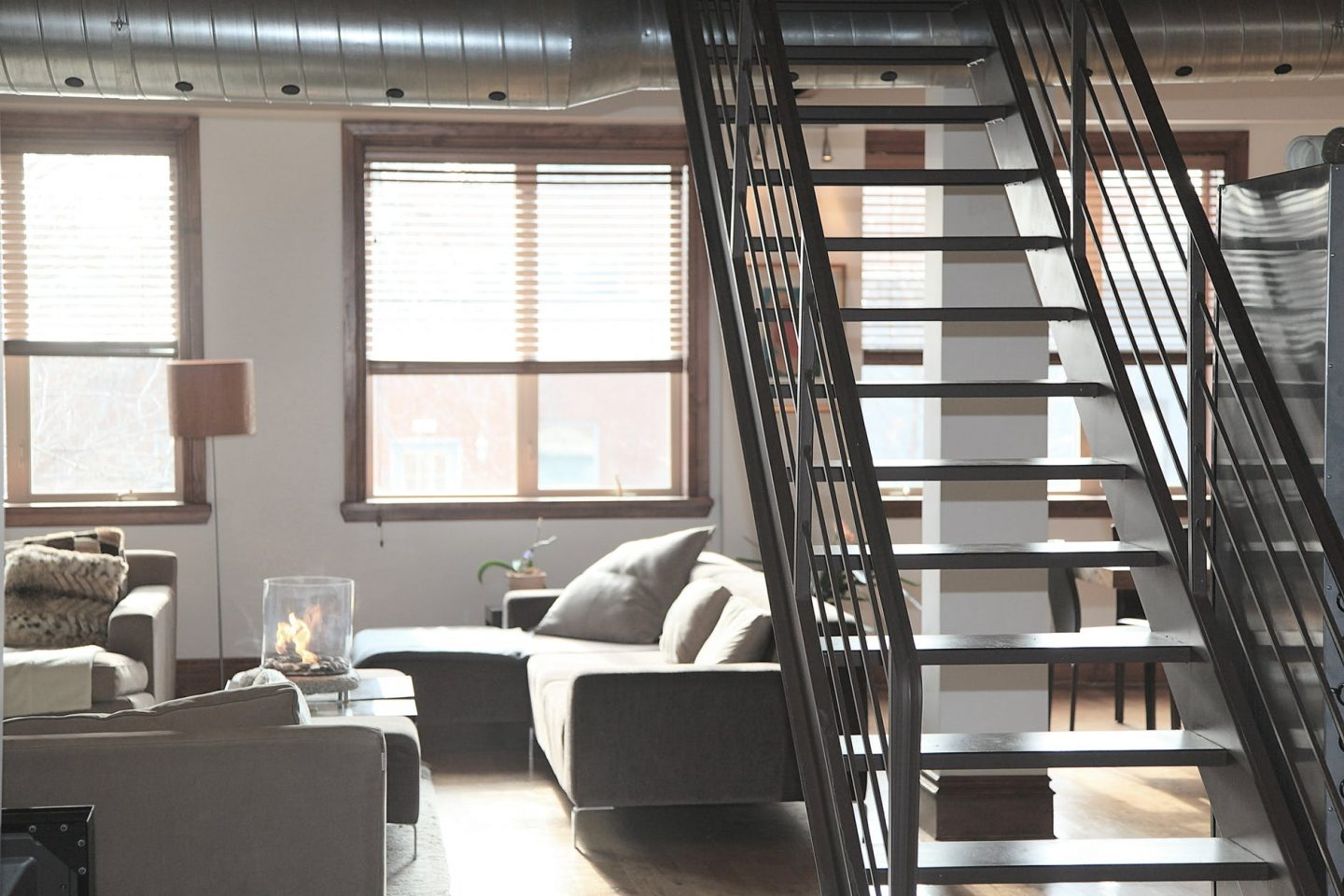Improve your humble abode: stairs from living room up to 1st floor in a house.