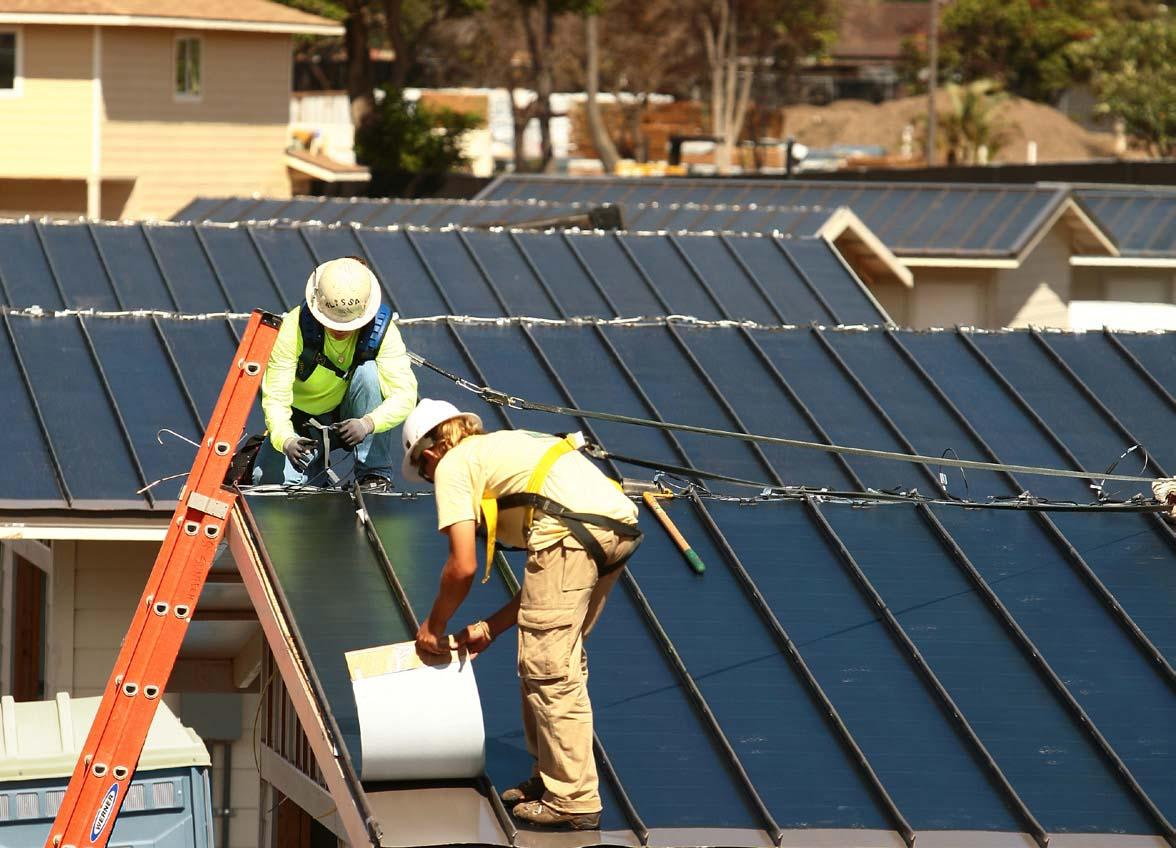 workers installing solar panels on roof - go solar.