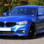 front number plate: Blue BMW with no front plate.
