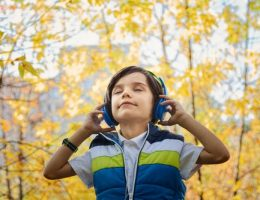boy with headphones on: causes of hearing loss in children