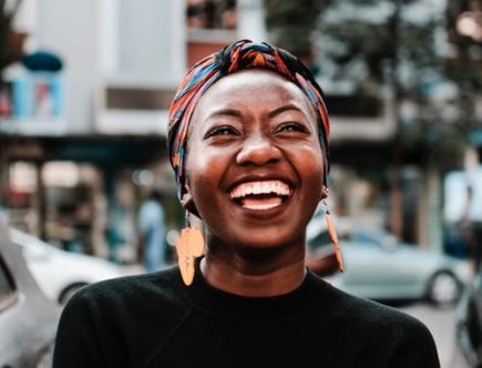 Lady smiling: investing in your smile.