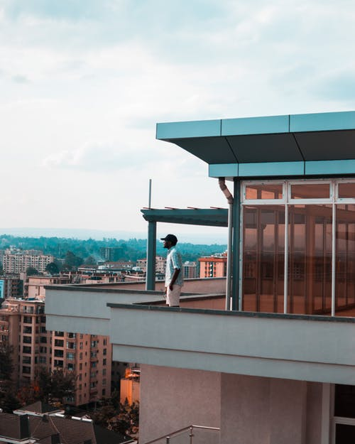 Flooring Options for the Balcony - Man standing on balcony