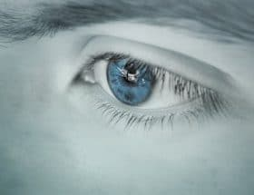 make your blue eyes pop: blue eye up close.