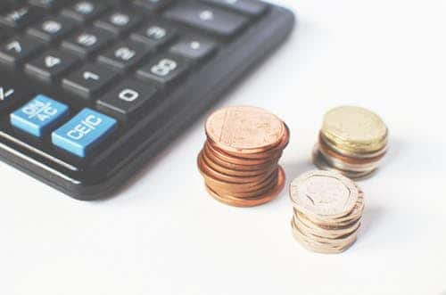 coins and a calculator: good with money