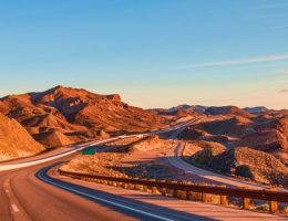 winding mountain road in the US in evening: pension pot if you're an expat