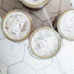 increase property value@ tins of paint on tiled white floor