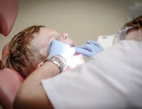 your mouth: child on a dentoists chair being examined