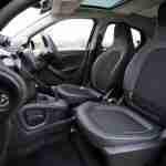 buying a new car: black car interior.