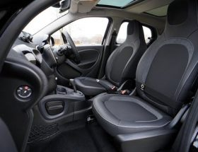 buying a new car: black car interior.