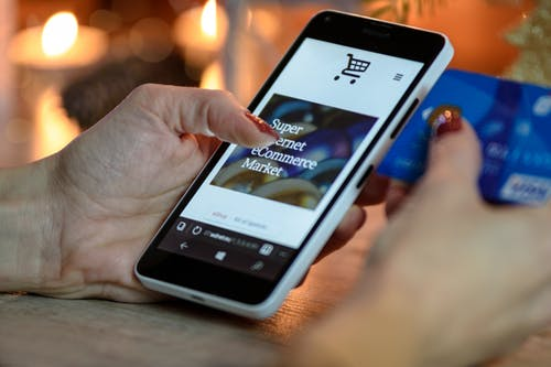 shop online: hand holding a smartphone