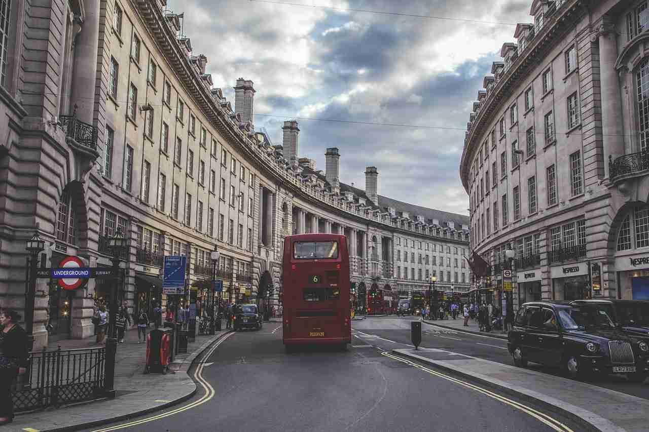 London on a budget: red double decker bus going down Regent Street.