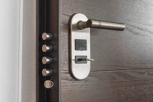 full service locksmith: brown door with various locks