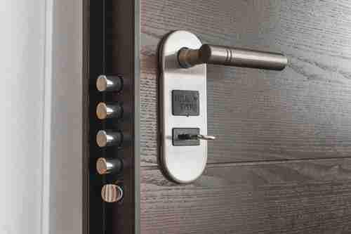 full service locksmith: brown door with various locks