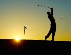 selection of golf jackets: golfer swinging club in sunset