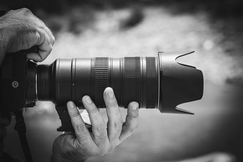 man holding a professional camera@ Boudoir Shoot