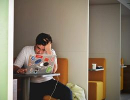 man on laptop with head in hands: get back on track