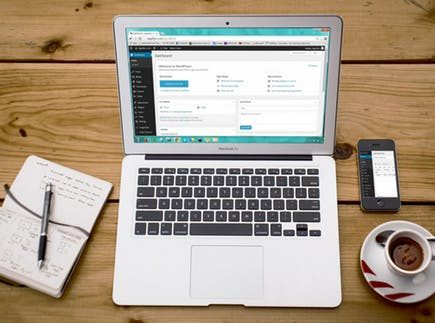 tips every blogger should know: laptop, smartphone and pad on wooden desk.