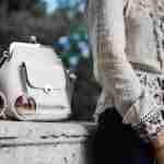 best luxury tops: young lady in a luxury top in garden
