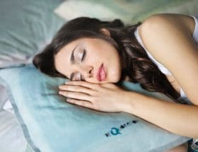 beauty sleep secrets: woman asleep on pillow