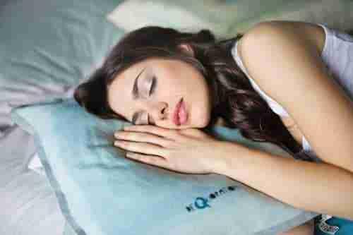 beauty sleep secrets: woman asleep on pillow